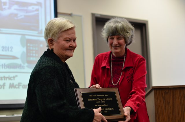 Tura Olson Graber received the plaque that will go in the room in the Larson House that she named after her father, Hartman Olson and her great grandfather, Tollef Olson.  More photos of the Annual Meeting.